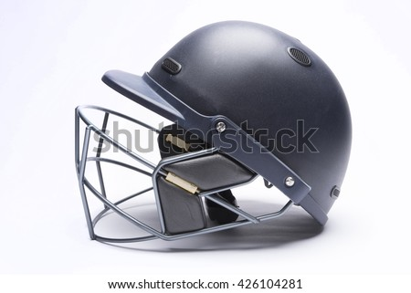 Modern day cricket batting helmet with protective grill on white background