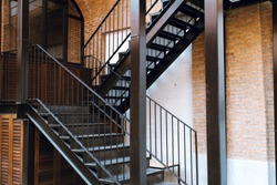 Modern design metal staircase with concrete building.