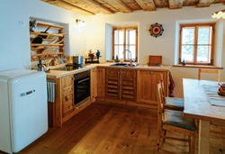 Modern design of Home Kitchen Interior made of wood. Wooden furniture in house. Dining room. Brown color. Table with chairs and sink. Window on background. Contemporary rustic, vintage handmade