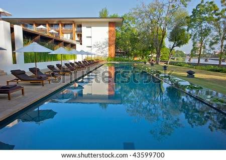 Modern Design Reflected In A Swimming Pool In An Asian Resort Stock ...