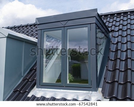 Modern design vertical roof window with black tiles