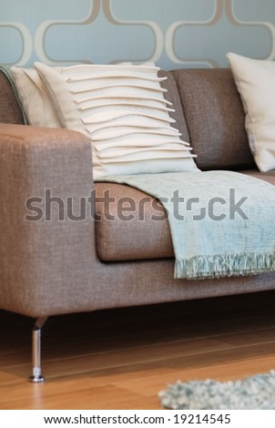 Modern designed sofa in blue and beige color