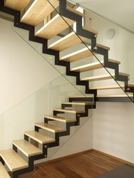 Modern designed stairs made with wood and glass