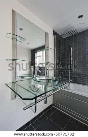modern designer bathroom with glass hand wash basin unit
