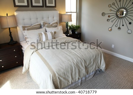 Modern designer bedroom with stylish furniture and decor.