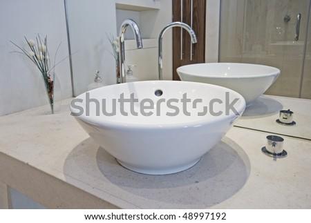 modern designer hand wash basin in a bowl shape