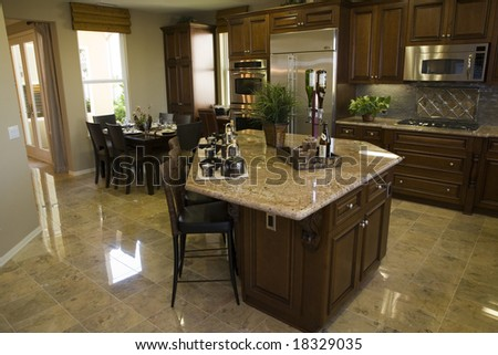 Modern designer kitchen with brown tiles.