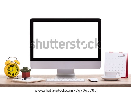 Modern desktop computer, Coffee cup, alarm clock, notebook and calendar on wooden table. Studio shot isolated on white background. Blank screen for graphics display montage. #767865985