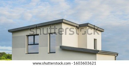 Modern detached house with flat roof