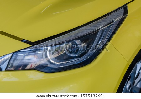 Modern details car yellow headlights.