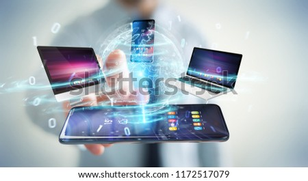 Modern devices connected to each other in businessman hand 3D rendering #1172517079