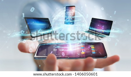 Modern devices connected to each other in businessman hand 3D rendering #1406050601