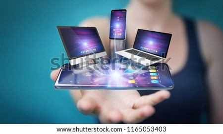 Modern devices connected to each other in businesswoman hand 3D rendering #1165053403