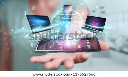 Modern devices connected to each other in businesswoman hand 3D rendering #1195529566