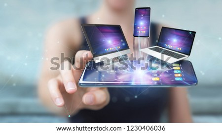 Modern devices connected to each other in businesswoman hand 3D rendering #1230406036