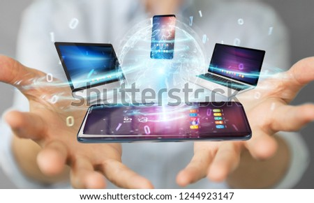 Modern devices connected to each other in businesswoman hand 3D rendering #1244923147