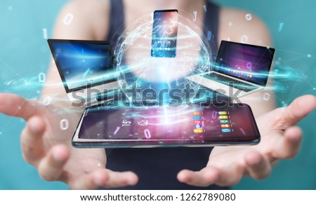 Modern devices connected to each other in businesswoman hand 3D rendering #1262789080