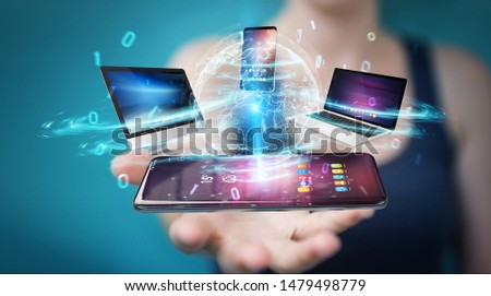 Modern devices connected to each other in businesswoman hand 3D rendering #1479498779