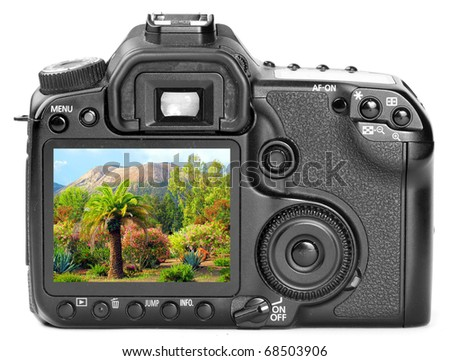Modern digital camera back side with picture of a tropical paradise ( Lipari island - Italy) on  a display.