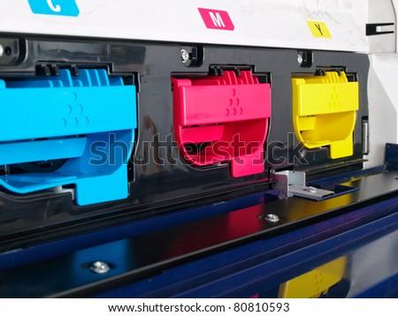 modern digital printing press, concept, closeup of the toner cartridges