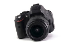 modern digital SLR photo camera with lens on white background. isolated.