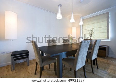 Modern dining area with massive wooden table and six chairs