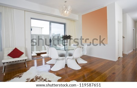 Modern dining area with round table and funky chairs