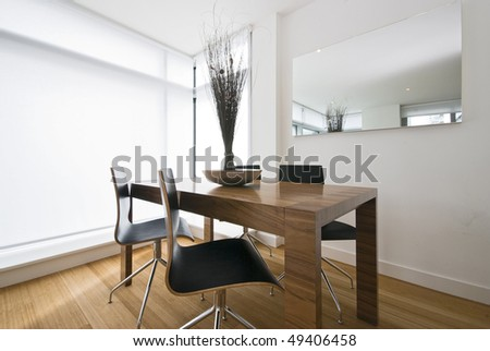 Modern dining area with wooden table and designer chairs