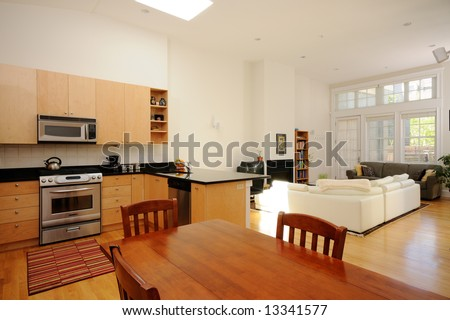 Modern dining room, kitchen and living room in open plan apartment