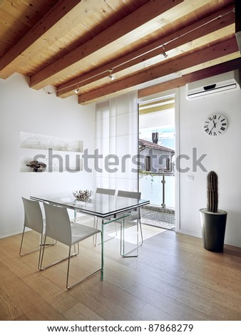 modern dining room overlooking  the balcony with ceiling and floor of wood