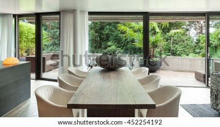 Modern dining room with table and floor hardwood #452254192