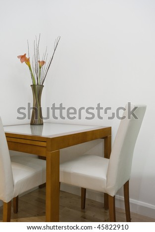 modern dining table detail with cut flowers