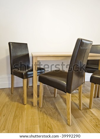 modern dining table with brown leather chairs