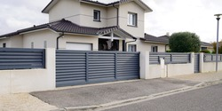 modern door gate of white two storey house driveway entrance gates home access garage in suburb