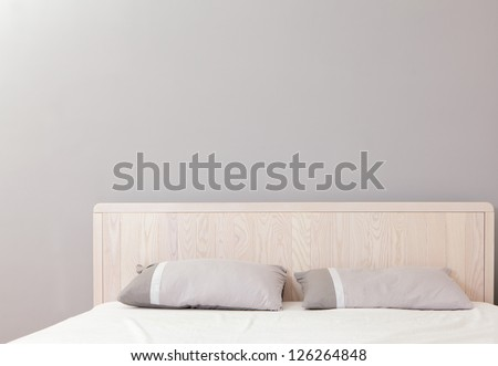 modern double bedroom with gray wall, great for copy space