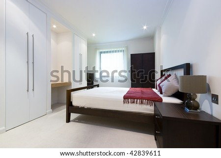 modern double bedroom with king size bed, built in wardrobes and bedside tables