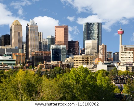 Modern downtown skyline full of skyscrapers - Calgary, Alberta Canada. Two symbols of Calgary downtown are visible - Bow Building (Encana building) and Calgary Tower.
