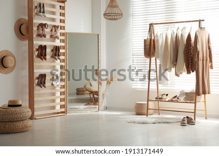 Modern dressing room interior with racks of stylish women's clothes and shoes Zdjęcia stock ©