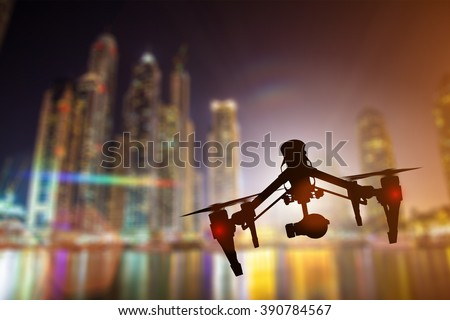 Modern drone in motion. Quadcopter with 4K camera flying.