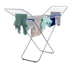 Modern drying rack with clothes on white background