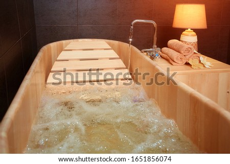 Modern eco-friendly wooden bathroom for hydro massage, relaxation and relaxation