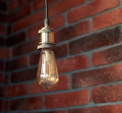 Modern edison loft decorative lamp hanging from the ceiling. Fixture of lamp. Minimalist interior design. Stylish bedroom and livingroom. Red brick wall in a designer minimalist room interior.