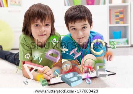 Modern education and online learning possibilities - boys using tablet computer