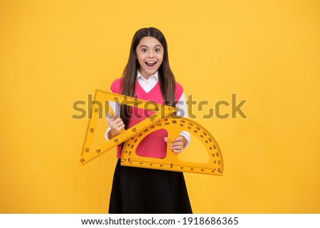 modern education concept. concept of education. measure the angle. child with triangle. amazed teen girl hold protractor ruler. back to school. algebra and geometry. kid study math. stem disciplines. Foto stock ©
