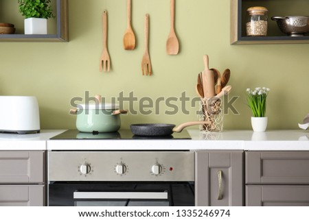 Modern electric stove with kitchenware
