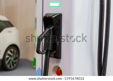 Modern electrical fast charger to electrical or hybrid PHEV automobiles. Future energy power. Ecology friendly charger. Clean ecology concept. Home electric car battery charger Stock photo ©