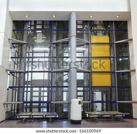 Modern elevator construction with glass walls from outside