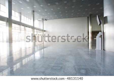 Modern empty building with informational terminal
