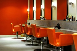 Modern empty hair saloon with chairs and mirrors