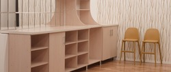 Modern Empty Large Dresser Or Cupboard, Sideboard In White Room Or Kitchen And Two Yellow High Chair On Parquet Floor